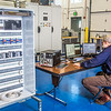 "Research technician David Light works in one of the modules in the Alaska Center for Energy and Power Technology Center.  <div class=""ss-paypal-button"">Filename: AAR-12-3479-013.jpg</div><div class=""ss-paypal-button-end"" style=""""></div>"