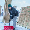 "Engineering major Tripp Collier clears snow from underneath forms used to hold the foundation during initial contruction of the 2014 ice arch, a tradition on the UAF campus for more than 50 years.  <div class=""ss-paypal-button"">Filename: AAR-14-4031-50.jpg</div><div class=""ss-paypal-button-end""></div>"