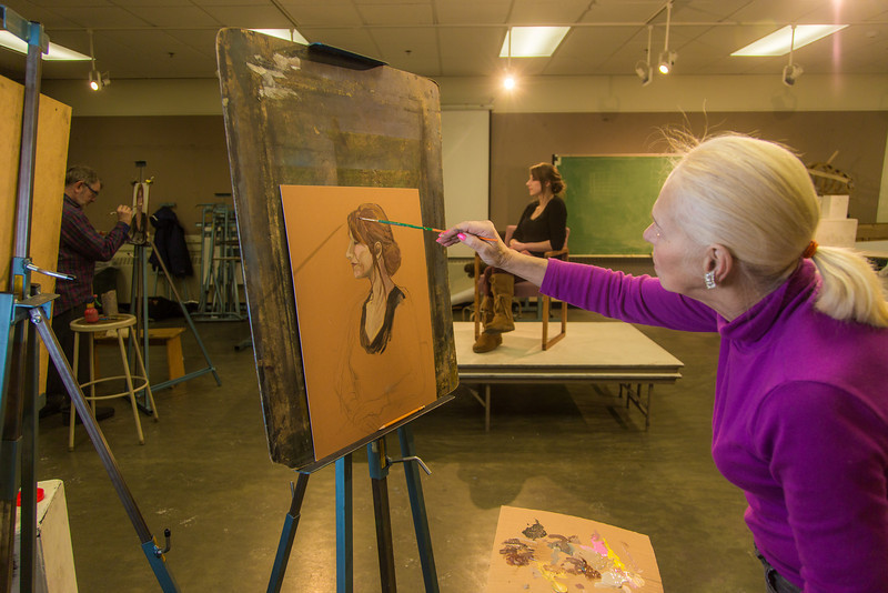 """Peggy Swartz at work during the portrait painting class in the UAF Fine Arts complex, offered during Wintermester 2014.  <div class=""""ss-paypal-button"""">Filename: AAR-14-4032-19.jpg</div><div class=""""ss-paypal-button-end"""" style=""""""""></div>"""
