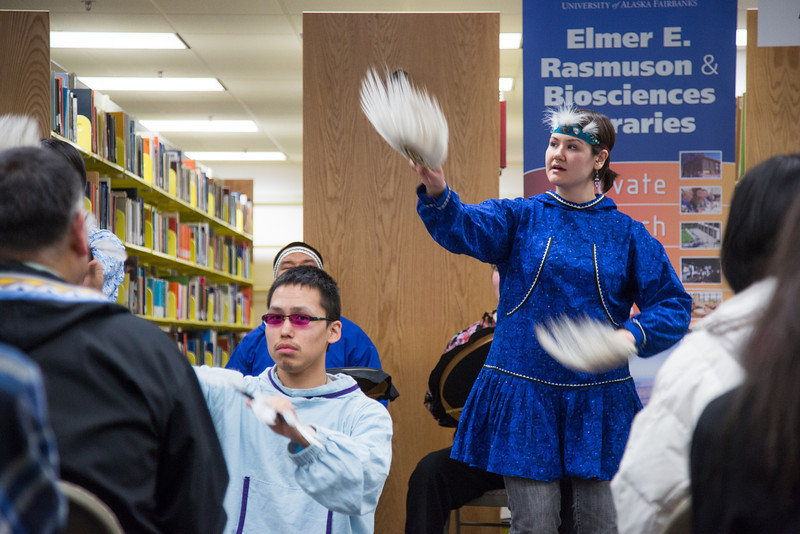 """Naaqtuuq Dommek of the UAF Iñu-Yupiaq Dance Group performs during the dedication ceremony of the Michael E. Krauss Alaska Native Language Archive Feb. 22, 2013, at the Rasmuson Library.  <div class=""""ss-paypal-button"""">Filename: AAR-13-3743-4.jpg</div><div class=""""ss-paypal-button-end"""" style=""""""""></div>"""