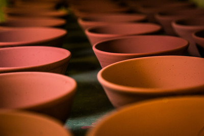 Ceramic bowls fresh out of the kiln cool on a shelf in UAF's ceramics studio. Art major Ian Wilkinson has thrown more than 1,000 of the same-sized bowls as part of his senior thesis.  Filename: AAR-13-3752-12.jpg