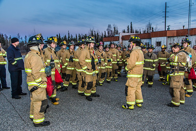 Students with the University Fire Department prepare for a regular live training drill at the Fairbanks Fire Training Center.  Filename: AAR-13-3978-1.jpg