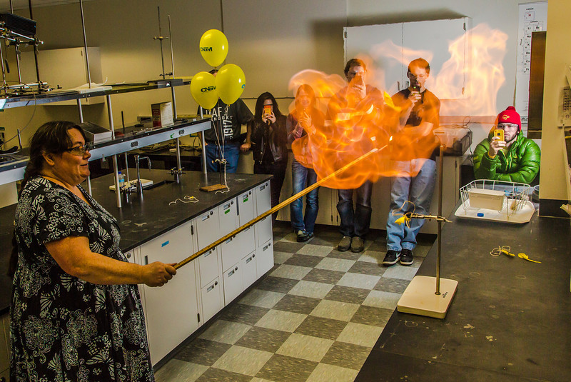 """UAF chemistry professor Cathy Cahill seems to enjoy blowing up balloons filled with hydrogen during a demonstration for her students in a Reichardt Building lab.  <div class=""""ss-paypal-button"""">Filename: AAR-13-4021-4.jpg</div><div class=""""ss-paypal-button-end"""" style=""""""""></div>"""
