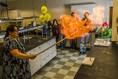 UAF chemistry professor Cathy Cahill seems to enjoy blowing up balloons filled with hydrogen during a demonstration for her students in a Reichardt Building lab.  Filename: AAR-13-4021-4.jpg