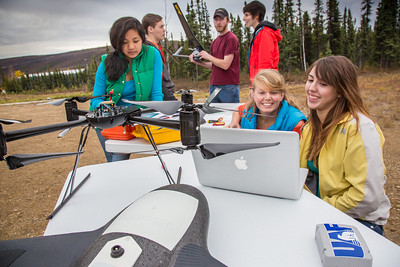 Students take part in a project using unmaned aerial vehicles (UAVs) at Poker Flat Research Range about 40 miles northeast of the Fairbanks campus. (Note: Taken as part of commercial shoot with Nerland Agency. Pretend class -- use with discretion!)  Filename: AAR-12-3560-051.jpg
