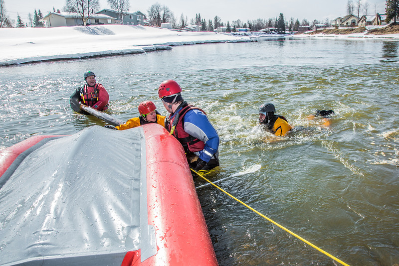 """Staff members and graduate students from the Water and Environmental Research Center (WERC) and the Institute of Northern Engineering (INE) receive swiftwater rescue and safety training in the Chena River.  <div class=""""ss-paypal-button"""">Filename: AAR-13-3813-105.jpg</div><div class=""""ss-paypal-button-end"""" style=""""""""></div>"""