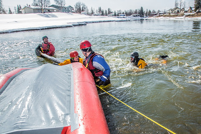Staff members and graduate students from the Water and Environmental Research Center (WERC) and the Institute of Northern Engineering (INE) receive swiftwater rescue and safety training in the Chena River.  Filename: AAR-13-3813-105.jpg