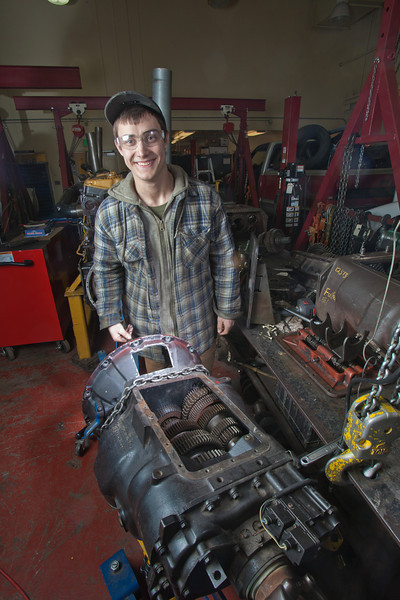 """George Jensen disassembles a transmission in the diesel mechanics lab at the Hutchison Institute of Technology.  <div class=""""ss-paypal-button"""">Filename: AAR-12-3312-063.jpg</div><div class=""""ss-paypal-button-end"""" style=""""""""></div>"""
