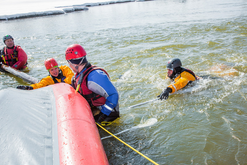 "Staff members and graduate students from the Water and Environmental Research Center (WERC) and the Institute of Northern Engineering (INE) receive swiftwater rescue and safety training in the Chena River.  <div class=""ss-paypal-button"">Filename: AAR-13-3813-104.jpg</div><div class=""ss-paypal-button-end"" style=""""></div>"
