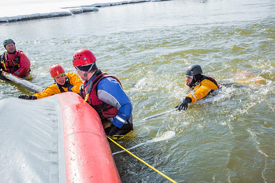 Staff members and graduate students from the Water and Environmental Research Center (WERC) and the Institute of Northern Engineering (INE) receive swiftwater rescue and safety training in the Chena River.  Filename: AAR-13-3813-104.jpg