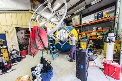 A UAF researcher works on a nautical buoy at the Seward Marine Center.  Filename: AAR-15-4475-184.jpg
