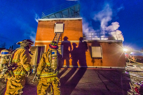"""Student fire fighters with the UFD practice evacuation and CPR techniques during a live training drill at the Fairbanks Fire Training Center.  <div class=""""ss-paypal-button"""">Filename: AAR-13-3978-155.jpg</div><div class=""""ss-paypal-button-end"""" style=""""""""></div>"""