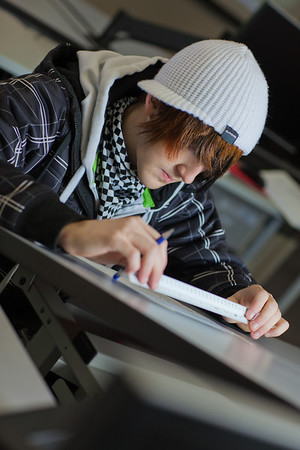 Jacob Carter works through his weekly drafting assignment at UAF's Community and Technical College.  Filename: AAR-11-3221-86.jpg