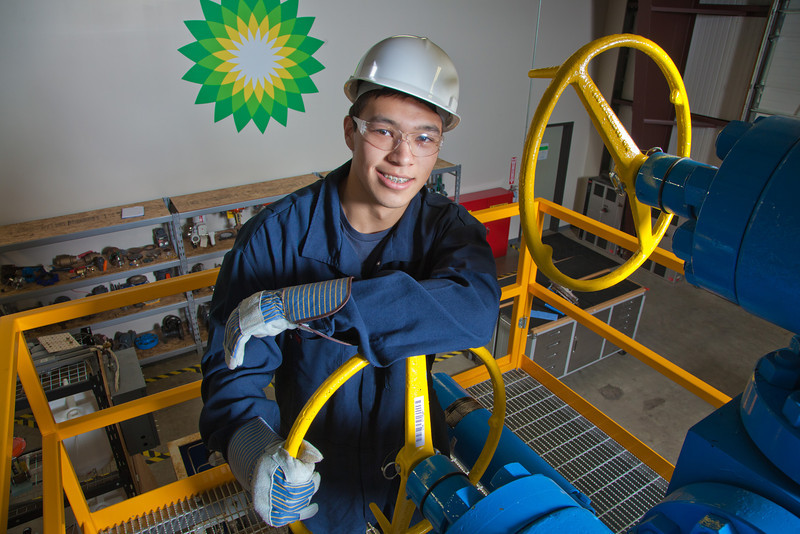 """Stefan Weingarth opens a valve on the oil field well head at CTC's process technology facility on Van Horn Road.  <div class=""""ss-paypal-button"""">Filename: AAR-11-3230-063.jpg</div><div class=""""ss-paypal-button-end"""" style=""""""""></div>"""