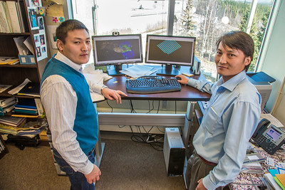 UAF graduate students Erdenebaatar Dondov, left, and Purevbaatar Narantsetseg study hard rock mine design in a Duckering Building faculty office. The duo is part of a partnership between UAF and the Mongolian government to establish a school of mining engineering there to educate locals to help develop the country's mineral resources.  Filename: AAR-13-3842-38.jpg
