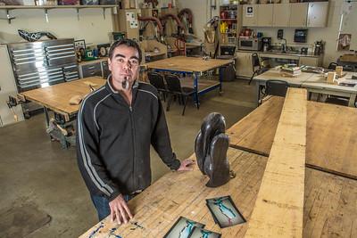 Assistant Professor of Native Arts Da-ka-xeen Mehner stands in his studio in the UAF FIne Arts Complex.  Filename: AAR-14-4354-01.jpg