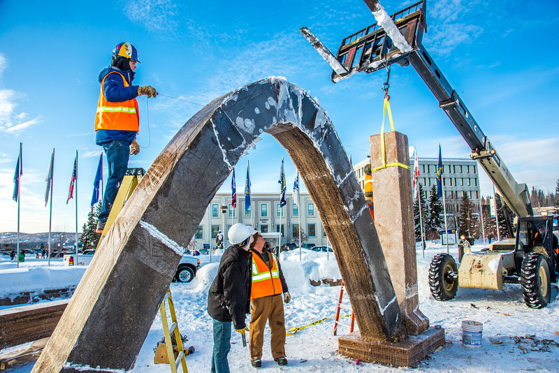 "Engineering students and volunteers from GHEMM Company raise the 2013 ice arch in Cornerstone Plaza on the Fairbanks campus. Students this year built the structure out of a mixture of ice and sawdust, which is many times stronger than concrete.  <div class=""ss-paypal-button"">Filename: AAR-13-3736-97.jpg</div><div class=""ss-paypal-button-end"" style=""""></div>"