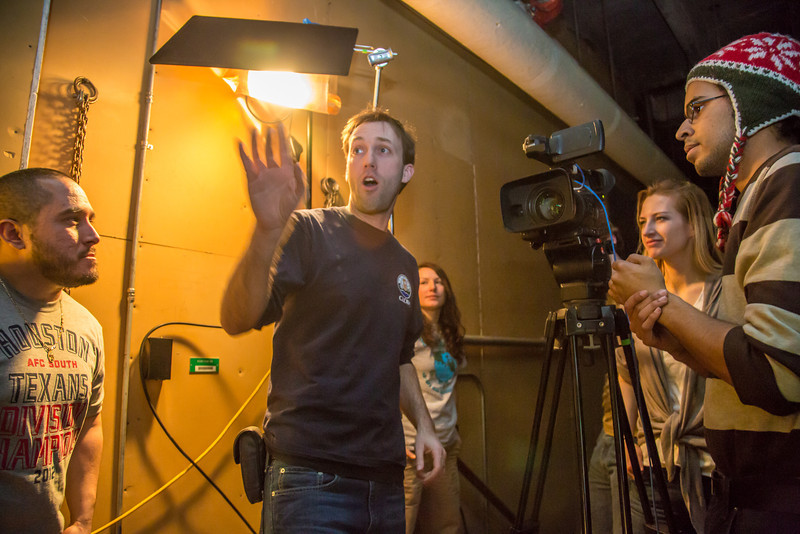 """Students in visiting lecturer Dave Selle's 2012 Wintermester cinematography class listen to comments before shooting a scene in the UAF Fine Arts complex.  <div class=""""ss-paypal-button"""">Filename: AAR-13-3690-17.jpg</div><div class=""""ss-paypal-button-end"""" style=""""""""></div>"""