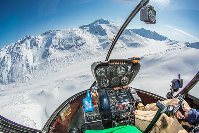 A helicopter is used to access research sites on the Jarvis Glacier, about 35 miles south of Delta Junction. A UAF team is nvestigating future flow in rivers coming directly from glaciers, as bridges and road networks can be affected by varying water levels.  Filename: AAR-13-3795-65.jpg