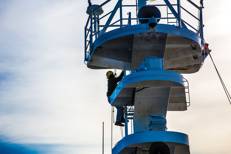 "An employee at the Marinette Marine Corporation climbs the rigging the day before the launch of the R/V Sikuliaq Oct. 12.  <div class=""ss-paypal-button"">Filename: AAR-12-3592-104.jpg</div><div class=""ss-paypal-button-end"" style=""""></div>"