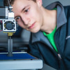 "Isaiah Ramirez keeps watch as his design project goes from concept to reality in UAF's Community and Technical College's 3-D print lab in downtown Fairbanks.  <div class=""ss-paypal-button"">Filename: AAR-16-4857-076.jpg</div><div class=""ss-paypal-button-end""></div>"
