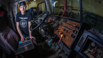 Jordan Young runs diagnostics on a big truck in the diesel mechanics lab at the Hutchison Institute of Technology.  Filename: AAR-12-3312-186.jpg