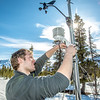 "Luke George, a senior mechanical engineering major and intern for the Alaska Center for Energy and Power, helps set up a remote meteorological station on a hillside near the Black Rapids Lodge, about 150 miles southeast of Fairbanks. The station will record wind speed and direction, as well as temperatures at different altitudes.  <div class=""ss-paypal-button"">Filename: AAR-13-3843-185.jpg</div><div class=""ss-paypal-button-end"" style=""""></div>"