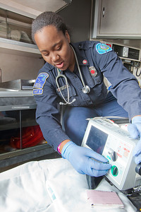 UAF student firefighter/EMT Lillian Hampton completes a training exercise in the back of an ambulance housed in the Whitaker Building on the Fairbanks campus.  Filename: AAR-11-3223-50.jpg