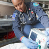 "UAF student firefighter/EMT Lillian Hampton completes a training exercise in the back of an ambulance housed in the Whitaker Building on the Fairbanks campus.  <div class=""ss-paypal-button"">Filename: AAR-11-3223-50.jpg</div><div class=""ss-paypal-button-end"" style=""""></div>"