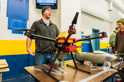 Logan Graves, a masters' student in electrical engineering, describes one of the unmanned aerial vehicles he's working with in his project during a class demonstration on the Patty Ice Arena.  Filename: AAR-15-4751 -41.jpg