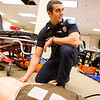 "EMT Student Michael Bellia checks the pulse of a medical training dummy while demonstrating a technique in front of his instructor.  <div class=""ss-paypal-button"">Filename: AAR-12-3444-2.jpg</div><div class=""ss-paypal-button-end"" style=""""></div>"
