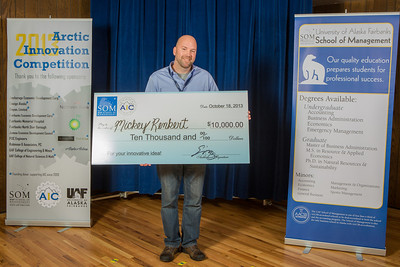 Mickey Remkert is all smiles after winning the grand prize of $10,000 in the Arctic Innovation Competition for the 2013 Arctic Innovation Competition for his multipurpose caulking tool idea.  Filename: AAR-13-3973-54.jpg