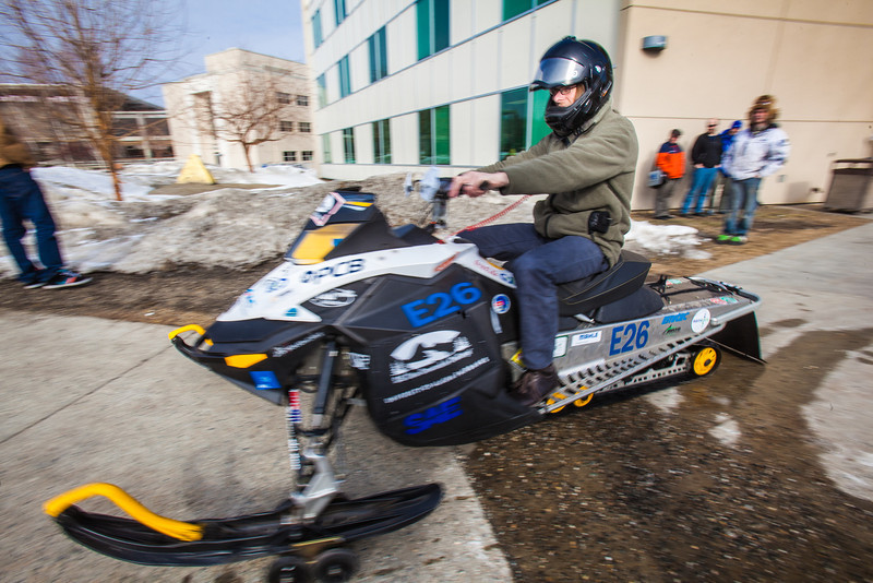 "UAF Sustainability Office Board Chair Brett Parks takes the clean snowmachine out for a test spin after it's return from winning the Society of Automotive Engineers' Clean Snowmobile Challenge in Houghton, Mich.  <div class=""ss-paypal-button"">Filename: AAR-12-3345-114.jpg</div><div class=""ss-paypal-button-end"" style=""""></div>"