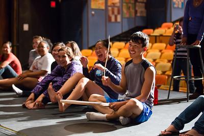 Thomas Brown of Kipnuk leads the young men in a comedic dance during RAHI's Alaska Native Dance class at the Salisbury Theater.  Filename: AAR-12-3452-37.jpg