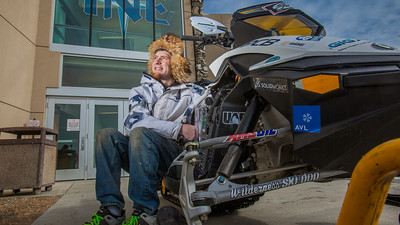 Mechanical enineering major Isaac Thompson poses with the UAF team's snowmobile in front of the Duckering Building after its return from competing in the Society of Automotive Engineers' Clean Snowmobile Challenge in Houghton, Mich.  Filename: AAR-12-3345-089.jpg