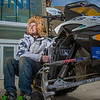 "Mechanical enineering major Isaac Thompson poses with the UAF team's snowmobile in front of the Duckering Building after its return from competing in the Society of Automotive Engineers' Clean Snowmobile Challenge in Houghton, Mich.  <div class=""ss-paypal-button"">Filename: AAR-12-3345-089.jpg</div><div class=""ss-paypal-button-end"" style=""""></div>"