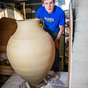 "Art major Ian Wilkinson removes one of his giant ceramic vessels he made as for his senior thesis from a kiln in the UAF ceramics studio.  <div class=""ss-paypal-button"">Filename: AAR-13-3744-31.jpg</div><div class=""ss-paypal-button-end"" style=""""></div>"