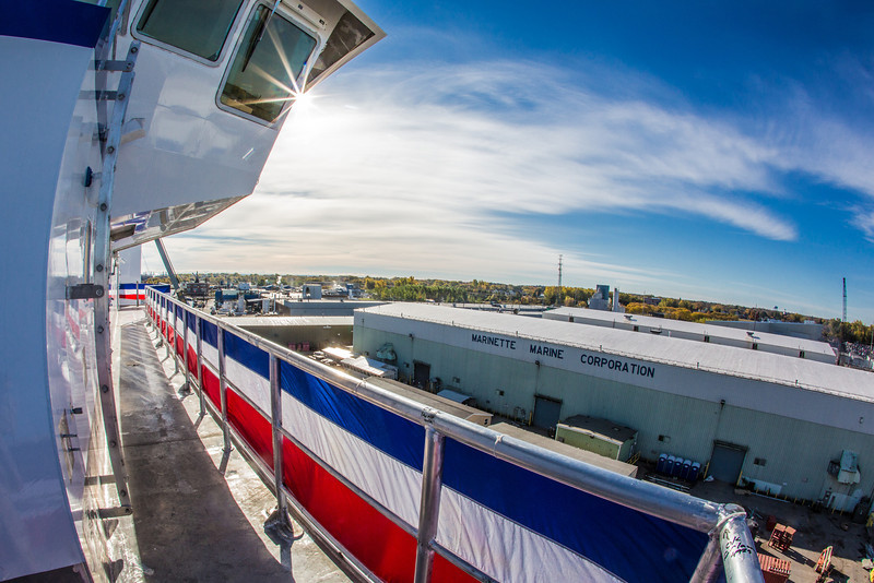 """Red, white and blue bunting adorns the railings on the R/V Sikuliaq the day before its launch in Marinette, Wisc.  <div class=""""ss-paypal-button"""">Filename: AAR-12-3592-135.jpg</div><div class=""""ss-paypal-button-end"""" style=""""""""></div>"""
