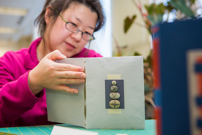 "Stehpanie Strandberg works on her project in a custom book binding workshop offered by UAF Summer Sessions during Wintermester 2013.  <div class=""ss-paypal-button"">Filename: AAR-13-3706-10.jpg</div><div class=""ss-paypal-button-end"" style=""""></div>"