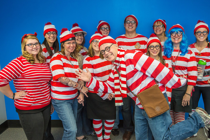 """School of Management Dean Mark Hermann, front and center, joined several members of his administrative staff in a Where's Waldo exercise for a Political Economy class.  <div class=""""ss-paypal-button"""">Filename: AAR-12-3621-71.jpg</div><div class=""""ss-paypal-button-end"""" style=""""""""></div>"""