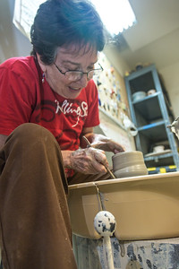 Local instructor Reyne Athanas works on a personal project in the ceramics studio at UAF's Kuskokwim Campus in Bethel.  Filename: AAR-16-4859-631.jpg
