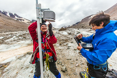 Professor Regine Hock, a glaciologist with UAF's Geophysical Institute, and Tristan Weiss, a research technician with the Institute of Northern Engineering, measure the depth of the ice near the toe of the Jarvis Glacier in the eastern Alaska Range.  Filename: AAR-14-4256-436.jpg