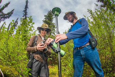 Associate professor Margaret Darrow, left, and state geologist Ronald Daanen take a reading from GPS tracking device as they make their way down one of several frozen debris lobes which have appeared along the Dietrich River valley in the southern Brooks Range  which could threaten the highway and the nearby trans-Alaska pipeline.  Filename: AAR-14-4214-135.jpg