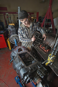 George Jensen disassembles a transmission in the diesel mechanics lab at the Hutchison Institute of Technology.  Filename: AAR-12-3312-059.jpg