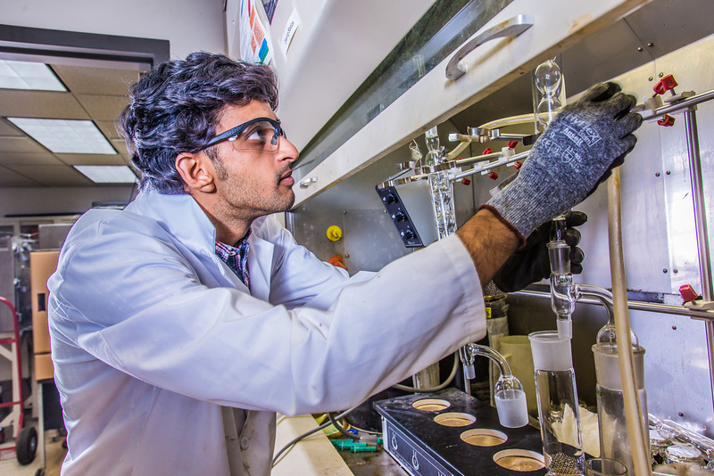 """Graduate student Mukul Chavan sets up apparatus for a procedure in UAF's Petroleum Development Lab in the Duckering Building.  <div class=""""ss-paypal-button"""">Filename: AAR-13-3918-154.jpg</div><div class=""""ss-paypal-button-end"""" style=""""""""></div>"""