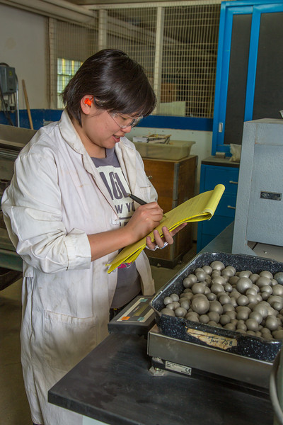 """Hsin-Hui Yen collects data after using steel ball bearings to crush ore as part of her research at the Mineral Industry Research Lab (MIRL) facility in the barn at the UAF Agricultural and Forestry Experiment Station.  <div class=""""ss-paypal-button"""">Filename: AAR-12-3549-073.jpg</div><div class=""""ss-paypal-button-end"""" style=""""""""></div>"""