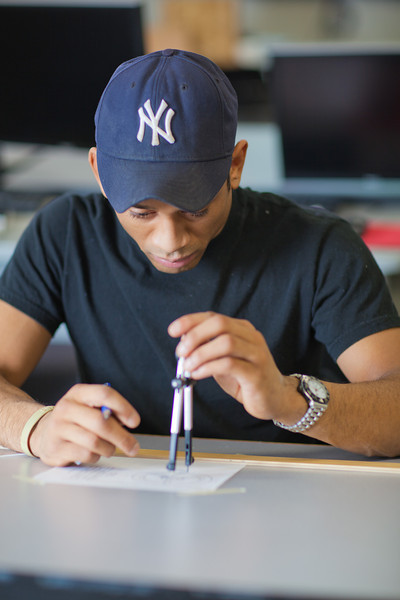 """Anthony Rogers completes the assignment in his drafting class in UAF's Community and Technical College.  <div class=""""ss-paypal-button"""">Filename: AAR-11-3221-93.jpg</div><div class=""""ss-paypal-button-end"""" style=""""""""></div>"""