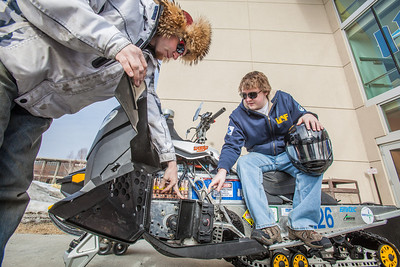 Team members Isaac Thompson, left, and Ben Neubauer, make some adjustments to their winning entry from the 2012 SAE Clean Snowmobile Challenge.  Filename: AAR-12-3345-042.jpg
