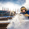 "Engineering major Ryan Williams-Cudo, project leader of the traditional ice arch project, brushes the previous night's snowfall off the main structure. Cudo and other student engineers designed and built the 2013 ice arch using a combination of water and sawdust to end up with a substance many times stronger than concrete.  <div class=""ss-paypal-button"">Filename: AAR-13-3733-29.jpg</div><div class=""ss-paypal-button-end"" style=""""></div>"
