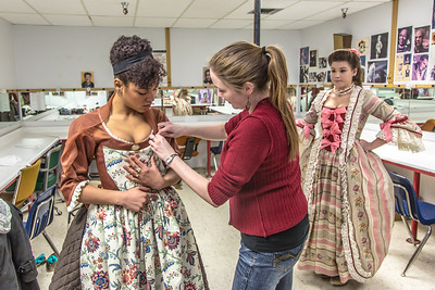 """Assistant professor Bethany Marx helps Nicole Cowans into her costume before Cowans, Katrina Kuharich (right) and other members of the cast of Theatre UAF's production of """"Tartuffe"""" performed a live teaser in Wood Center a couple of days before opening night.  Filename: AAR-14-4121-11.jpg"""